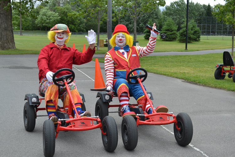 Clowns on pedal cars